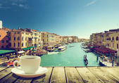 Coffee on table and Venice in sunset time, Italy — Stock Photo