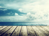 Tropical beach and wooden platform — Stock Photo