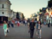 Street in european city in bokeh — Stock Photo