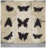 Nature butterflies silhouettes sign vector set — Stock Vector