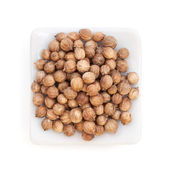 Coriander Seeds (Coriandrum sativum) in a white bowl on white — Stock Photo