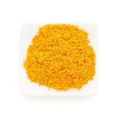 Curry ground (Madras Curry) in a white bowl on white background. — Stock Photo