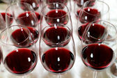 Wine glasses row over the party background — Stock Photo