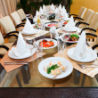 Stock Photo: Catering table set service with silverware and glass stemware at