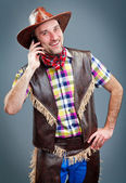 Cowboy is talking on the phone and smiling. — Stock Photo