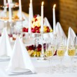 Romantic table with burning candles and champagne - Stock Photo