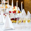 Stock Photo: Romantic table with burning candles and champagne