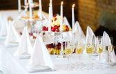 Romantic table with burning candles and champagne — Stock Photo