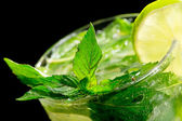 Mojito cocktail on black background — Stock Photo
