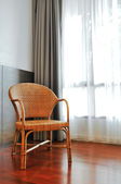 Wicker chair in living room — Stock Photo