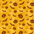 Halloween pumpkins, bats and spiders seamless background — Stock vektor