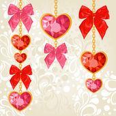 Shiny ruby heart pendants hanging — Stock Vector