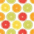Stock Vector: Fresh colorful citrus fruits seamless pattern