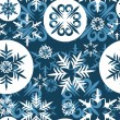 Christmas and New Year seamless pattern with snowflakes - Stockvectorbeeld