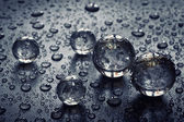Glass balls, water droplets — Stock Photo