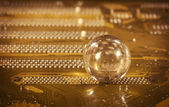 Glass ball and detail of PC — Stock Photo
