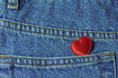 Little heart in jeans pocket — Stock Photo