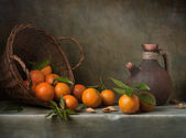Still life with tangerines and basket — Stock Photo