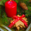 Christmas gingerbread cookies and red candle — Stock Photo