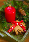 Christmas gingerbread cookies and red candle — Stockfoto
