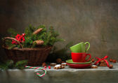 Christmas still life with cups and candy cane — Stok fotoğraf