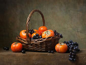 Still life with persimmons — Stock Photo