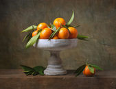 Vintage still life with tangerines — Stock Photo