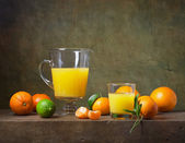 Still life with citrus fruit and orange juice — Stock Photo