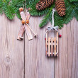 Fir branches with cones and Christmas decorations on wooden boards — Stock Photo