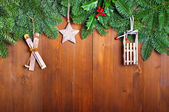 Fir branches and  Christmas decorations on wooden boards — Stock fotografie
