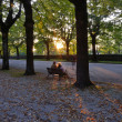 Couple on bench at sunset — Stock Photo