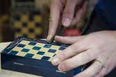 Artisan carve chessboard — Stock Photo