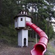 Stock Photo: Clubhouse with spiral slide