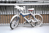 Bicycle covered by snow — Stock Photo