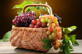 Basket with pink and black grapes. — Stock Photo