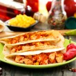 Mexican wheat tortillas with spicy stuffing. - Foto Stock