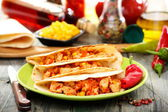 Mexican wheat tortillas with spicy stuffing. — Stock Photo