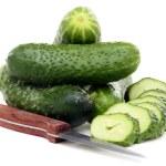 Постер, плакат: Fresh juicy cucumbers and knife for cutting vegetables