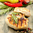 Stock Photo: Fillet of turkey with rosemary and pepper.