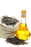 Sunflower seeds and oil in bottle. — Stock Photo