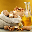 Stock Photo: Walnut oil in bottle and nuts.