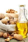 Walnut oil and nuts in a bag. — Stock Photo