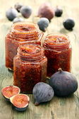 Figs and homemade jam in glass jars. — Stock Photo