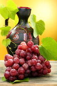 Pitcher and bunch of grapes. — Stock Photo