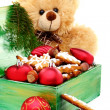 Christmas box with toys and cookies. — Stock Photo