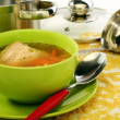 Soup in bowl and stainless steel pan. - 图库照片