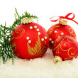 Christmas red balls on the snow. - Stock Photo
