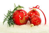 Christmas red balls on the snow. — Stock Photo