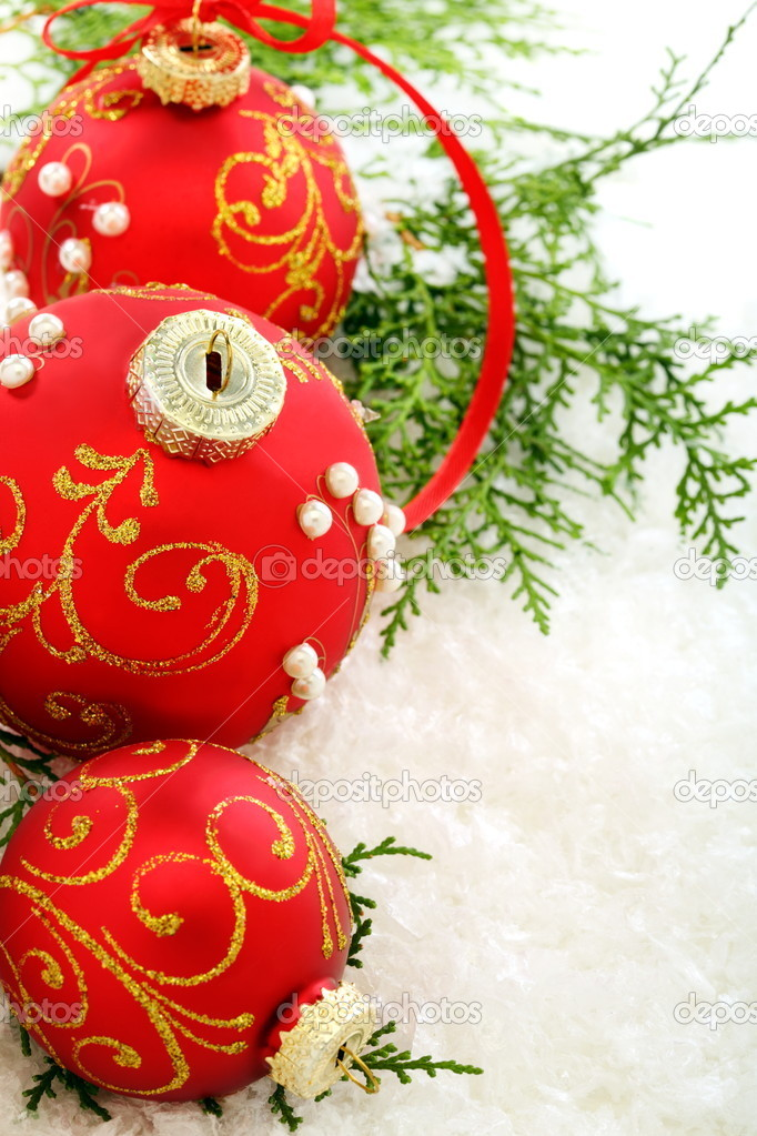 Three red Christmas ball and green branches on the snow.  Stock Photo #13979813