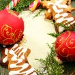 Christmas balls, gingerbread and candy cane. — Stock Photo
